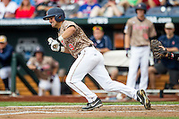 Virginia Cavaliers third baseman Kenny Towns (9) lays down a bunt against the Arkansas Razorbacks in Game 1 of the NCAA College World Series on June 13, 2015 at TD Ameritrade Park in Omaha, Nebraska. Virginia defeated Arkansas 5-3. (Andrew Woolley/Four Seam Images)