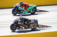 Oct 16, 2016; Ennis, TX, USA; NHRA pro stock motorcycle rider Angelle Sampey (near) races alongside Shawn Gann during the Fall Nationals at Texas Motorplex. Mandatory Credit: Mark J. Rebilas-USA TODAY Sports