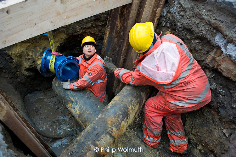 Workers employed by La Cile, a publicly owned water company, replace pipes under a road in the centre of Liege, Belgium.