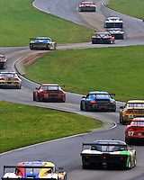 A line of cars races up a hill and throgh the esses at Virginia International Raceway during the Bosch Engineering 250 Grand-Am Rolex Series race iin Alton, VA, May 14,  2011.  (Photo by Brian Cleary/www.bcpix.com)