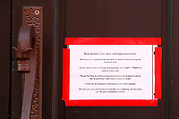 A sign on the door of Umami is shown on Friday March 20, 2020 in the Lawrenceville neighborhood of Pittsburgh, Pennsylvania. (Photo by Jared Wickerham/Pittsburgh City Paper)