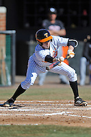 Tennessee Volunteers shortstop A.J. Simcox #10 lays down a bunt during a game against the UNLV Runnin' Rebels at Lindsey Nelson Stadium on February 22, 2014 in Knoxville, Tennessee. The Volunteers defeated the Rebels 5-4. (Tony Farlow/Four Seam Images)