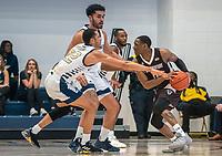 WASHINGTON, DC - JANUARY 5: Amir Harris #22 of George Washington defends against Kyle Lofton #0 of St. Bonaventure during a game between St. Bonaventure University and George Washington University at Charles E Smith Center on January 5, 2020 in Washington, DC.