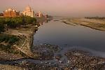 The Taj Mahal and the Yamuna River at sunrise. Agra, India.