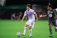 LAKE BUENA VISTA, FL - AUGUST 06: Mauricio Pereyra #10 of Orlando City SC passes the ball during a game between Orlando City SC and Minnesota United FC at ESPN Wide World of Sports on August 06, 2020 in Lake Buena Vista, Florida.