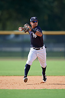 New York Yankees Eduardo Torrealba (9) throws to first base during a Florida Instructional League game against the Philadelphia Phillies on October 11, 2018 at Yankee Complex in Tampa, Florida.  (Mike Janes/Four Seam Images)