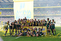 Mathew Tait (left) brings the trophy as Leicester Tigers celebrate winning the Aviva Premiership Final between Leicester Tigers and Northampton Saints at Twickenham Stadium on Saturday 25th May 2013 (Photo by Rob Munro)