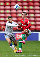 10th October 2020; Bescot Stadium, Walsall, West Midlands, England; English Football League Two, Walsall FC versus Colchester United; Alfie Bates of Walsall challenges for the aerial ball with Noah Chilvers of Colchester United
