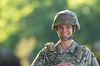 Solo portrait of a US Military woman in uniform photographed in natural light.  Stock photo for sale for advertising.