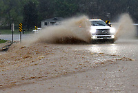 A motorist plows through a flooded section of Arkansas 12 on Wednesday April 28 2021 near Beaver Lake east of Rogers. Go to nwaonline.com/210428Daily/ to see more photos.<br /> (NWA Democrat-Gazette/Flip Putthoff)