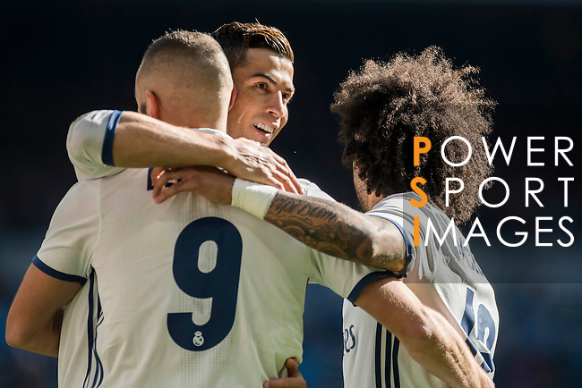 Karim Benzema of Real Madrid celebrates with teammates  Cristiano Ronaldo and Marcelo Vieira Da Silva of Real Madrid during their La Liga match between Real Madrid and Granada CF at the Santiago Bernabeu Stadium on 07 January 2017 in Madrid, Spain. Photo by Diego Gonzalez Souto / Power Sport Images