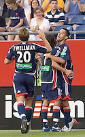 Clint Dempsey's celebrates his second goal with teammates. The New England Revolution defeat Red Bull NY, 3-2, July 1at Gillette Stadium.