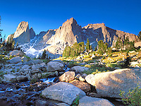 Sunrise light hits the War Bonnet Peaks in the Circ of the Towers, Wind River Range, Wyoming.