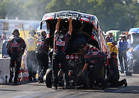 Aug. 17, 2013; Brainerd, MN, USA: Crew members for NHRA funny car driver Matt Hagan during qualifying for the Lucas Oil Nationals at Brainerd International Raceway. Mandatory Credit: Mark J. Rebilas-