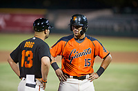 AZL Giants designated hitter Ricardo Genoves (15) talks to manager Hector Borg during a game against the AZL Padres 2 on July 13, 2017 at Scottsdale Stadium in Scottsdale, Arizona. AZL Giants defeated the AZL Padres 2 11-3. (Zachary Lucy/Four Seam Images)