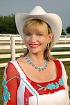 Diane Cain wearing a blue topaz and pearl necklace at the Cattle Baron's Ball at the George Ranch Saturday April 28,2007.(Dave Rossman/For the Chronicle)