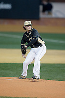 Wake Forest Demon Deacons starting pitcher Matt Pirro (1) delivers a pitch to the plate against the Delaware Blue Hens at Wake Forest Baseball Park on February 13, 2015 in Winston-Salem, North Carolina.  The Demon Deacons defeated the Blue Hens 3-2.  (Brian Westerholt/Four Seam Images)
