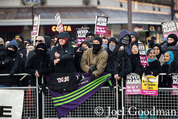 "© Joel Goodman - 07973 332324 . 26/11/2016 . Bolton , UK . Anti fascists pictured holding a counter demonstration . Approximately 100 people attend a demonstration against the construction of mosques in Bolton , under the banner "" No More Mosques "" , organised by a coalition of far-right organisations and approximately 150 anti fascists opposing the demonstration , in Victoria Square in Bolton Town Centre . Photo credit : Joel Goodman"