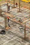 Concrete forms being installed to make floors in high rise buildings