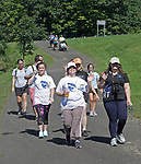 Middlebury, CT-091618MK02 Walkers approach the finish at the 8th annual Hydrocephalus walk at Meadowview Park in Middlebury Saturday morning. Jenifer Jeans, event organizer, said that 100 walkers participated in the annual event to raise awareness and funds for a brain condition that affects roughly 1 million people nationwide. Michael Kabelka / Republican-American
