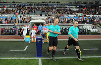 Match referee Mike Dean picks up the match ball. Barclays Premier League match between Swansea City and Tottenham Hotspur played at The Liberty Stadium, Swansea on October 4th 2015