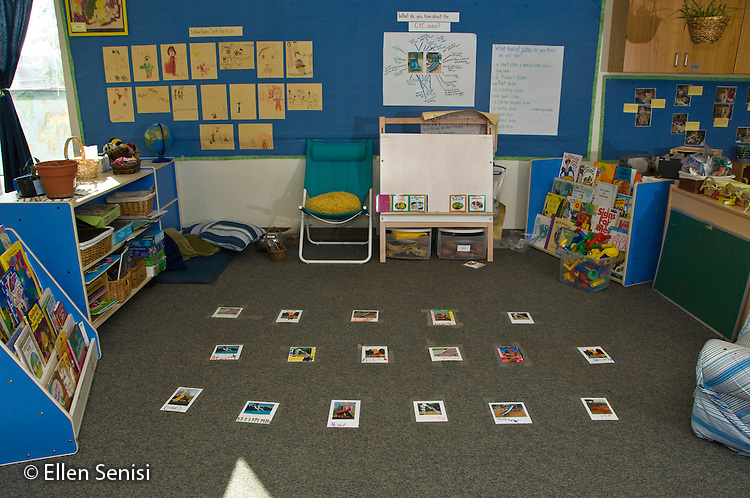 MR / College Park, Maryland.Center for Young Children, laboratory school within the College of Education at the University of Maryland. Full day developmental program of early childhood education for children of faculty, staff, and students at the university..Age-appropriate early childood education classroom environment showing meeting area with cards taped to floor designating where students sit, student art work on walls, and books on shelves..MR: AH-gPcyc.© Ellen B. Senisi