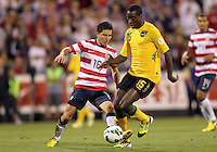 COLUMBUS, OHIO - SEPTEMBER 11, 2012:  Jose Torres (16) of the USA MNT gets the ball from JeVaughan Watson (15) of  Jamaica during a CONCACAF 2014 World Cup qualifying  match at Crew Stadium, in Columbus, Ohio on September 11. USA won 1-0.