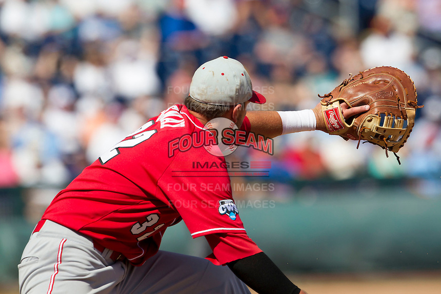 North Carolina State first baseman Tarran Senay (32) makes a putout at first during Game 3 of the 2013 Men's College World Series between the North Carolina State Wolfpack and North Carolina Tar Heels at TD Ameritrade Park on June 16, 2013 in Omaha, Nebraska. The Wolfpack defeated the Tar Heels 8-1. (Andrew Woolley/Four Seam Images)