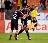 Nick DeLeon (18) of D.C. United celebrates his goal with teammate Chris Korb (22) during a Major League Soccer game at RFK Stadium in Washington, DC. D.C. United tied the Philadelphia Union, 1-1.
