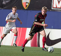 The MetroStars' John Wolyniec is trailed by D.C. United's Bryan Namoff. D. C. United was defeated by the NY/NJ MetroStars 3 to 2 during the MetroStars home opener at Giant's Stadium, East Rutherford, NJ, on April 17, 2004.