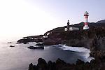 Spain, Canary Islands, La Palma, the southernmost point near Los Canarios Fuencaliente, Punta de Fuencaliente: old and new lighthouse Faro de Fuencaliente at dusk