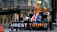 NEW YORK, NEW YORK - MARCH 08: People protest in the sidewalk against the former U.S. president Donald Trump at Trump Tower on March 08, 2021 in New York. Trump is returning to New York for the first time after leaving the White House at a time when several New York prosecutors are investigating his businesses for possible fraud crimes. (Photo by John Smith/VIEWpress)