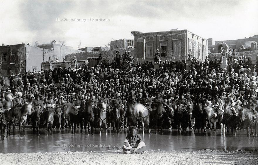 Iran 1946 Gathering of people and riders in Mahabad during the Republic of Kurdistan.<br /> Iran 1946 Rassemblement d'habitants et de cavaliers a Mahabad pendant la Republique du Kurdistan