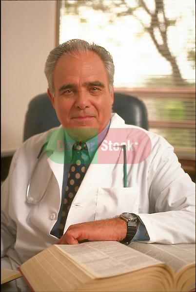 portrait of elder doctor sitting in doctor's office