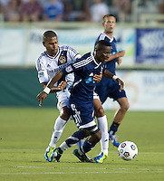 Leonardo (22) of the LA Galaxy fouls Tiyi Shipalane (11) of the Carolina Railhawks during a third round match in the US Open Cup at WakeMed Soccer Park in Cary, NC.  The Carolina Railhawks defeated the LA Galaxy, 2-0.