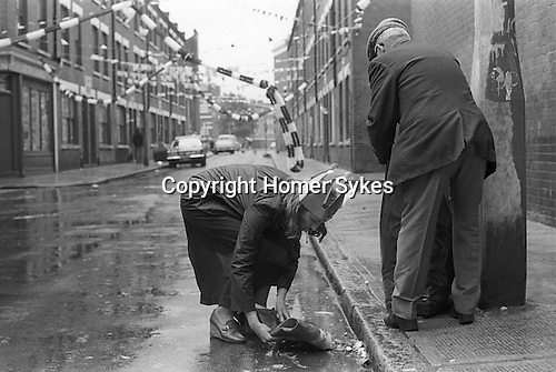 Silver Jubilee Street Party 1977.  Whitechapel Tower Hamlets, east end London cleaning up after Repton street,  Street Party. <br /> <br /> My ref 34/2060/,1977,