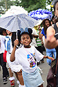 Members of the Baby Doll Sisterhood second line in memory of Baby Doll Tee Eva Perry, who died at 83 on June 7, in New Orleans, La. Monday, June 11, 2018. JaÕNiya 'G-Baby Doll' Dabney