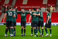 23rd December 2020; Bet365 Stadium, Stoke, Staffordshire, England; English Football League Cup Football, Carabao Cup, Stoke City versus Tottenham Hotspur; Ben Davies of Tottenham Hotspur celebrates his goal with Son Heung-min and team mates for 1-2 in the 70th minute
