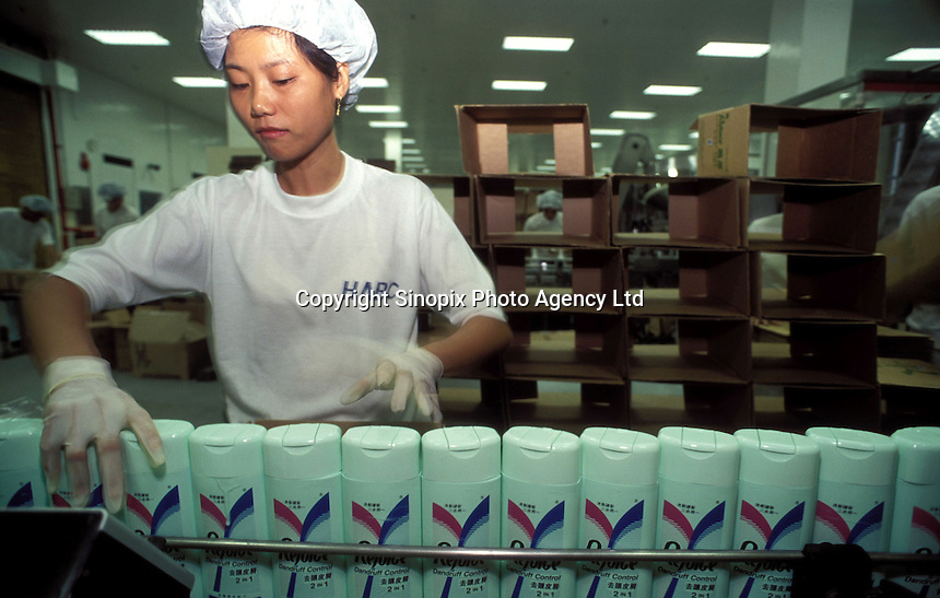 A female worker at the Rejoice (shampoo) production line of a  Procter and Gamble  factory in Guangzhou, China.