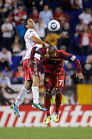 Carlos Mendes (44) of the New York Red Bulls and Andy Williams (77) of Real Salt Lake go up for a header. Real Salt Lake defeated the New York Red Bulls 3-1 during a Major League Soccer (MLS) match at Red Bull Arena in Harrison, NJ, on September 21, 2011.