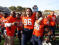 Oct 30, 2010; Charlottesville, VA, USA;   Virginia Cavaliers defensive tackle Nick Jenkins (96) and Virginia Cavaliers cornerback Devin Wallace (28) celebrate after the 24-19 upset win over the Miami Hurricanes at Scott Stadium. Mandatory Credit: Andrew Shurtleff