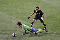 COLUMBUS, OH - DECEMBER 12: Nicolas Lodeiro #10 of the Seattle Sounders FC is fouled by Artur #8 of the Columbus Crew during a game between Seattle Sounders FC and Columbus Crew at MAPFRE Stadium on December 12, 2020 in Columbus, Ohio.