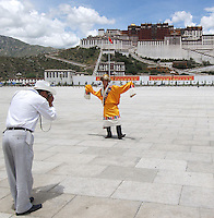 Chinese tourists pose for pictures before the Potala Palace, Lhasa, Tibet..13 Jul 2006