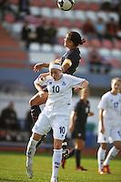 USA Captain, #7 Shannon Boxx, wins a header over Iceland's #10, Dora Maria Larufsdottier, in Vila Real Sto. Antonio at the Algarve Cup in Portugal.