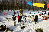 Allen Moore passes the unofficial *Muffin Checkpoint* at mile 4 on the ceremonial start day of the Iditarod Anchorage
