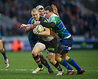 Mike Brown of Harlequins is tackled by Robbie Henshaw of Connacht Rugby during the Heineken Cup match between Harlequins and Connacht Rugby at The Twickenham Stoop on Saturday 12th January 2013 (Photo by Rob Munro).