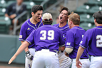 Catcher Danny Bermudez (21) of Western Carolina, left,  shouts after hitting a home run in the ninth inning against Mercer in the final game of the SoCon Tournament championship series on Sunday, May 29, 2016, at Fluor Field at the West End in Greenville, South Carolina. Western won, 3-2. (Tom Priddy/Four Seam Images)