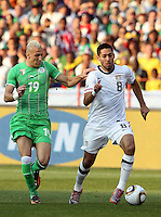 Clint Dempsey (8) controls the ball ahead of Hassan Yebda (19). USA defeated Algeria 1-0 in stoppage time in the 2010 FIFA World Cup at Loftus Versfeld Stadium in Pretoria, Sourth Africa, on June 23th, 2010.