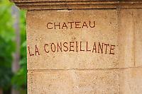 A stone gate post with the inscription Chateau La Conseillante Pomerol Bordeaux Gironde Aquitaine France