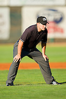 Umpire Farris Pierson handles the calls on the bases during the Pioneer League game between the Orem Owlz and the Ogden Raptors at Lindquist Field on July 28, 2012 in Ogden, Utah.  The Raptors defeated the Owlz 8-7.   (Brian Westerholt/Four Seam Images)